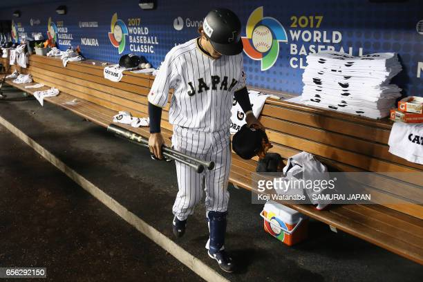 Infielder Nobuhiro Matsuda of Japan is seen in the dugout after his team's defeat against the United States in the World Baseball Classic...