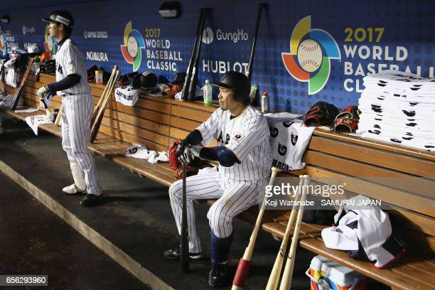 Infielder Nobuhiro Matsuda of Japan shows dejection in the dugout after his team's defeat against the United States in the World Baseball Classic...