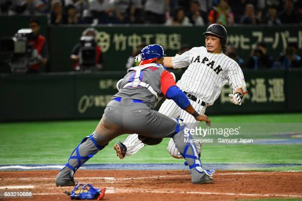 Infielder Nobuhiro Matsuda of Japan slides safely into the home plate to score a run to make it 55 by a RBI single of Catcher Seiji Kobayashi in the...
