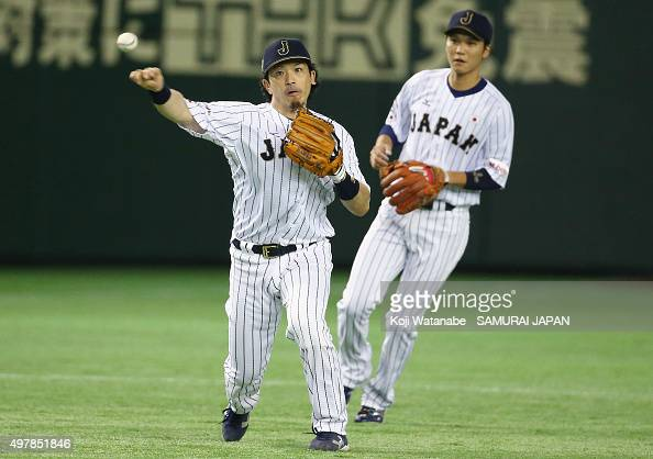 Infielder Nobuhiro Matsuda of Japan throws to the first base in the top of first inning during the WBSC Premier 12 semi final match between South...
