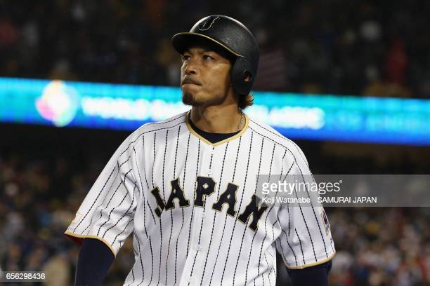 Infielder Nobuhiro Matsuda of Japan walks to the dugout after striking out in the bottom of the ninth inning during the World Baseball Classic...