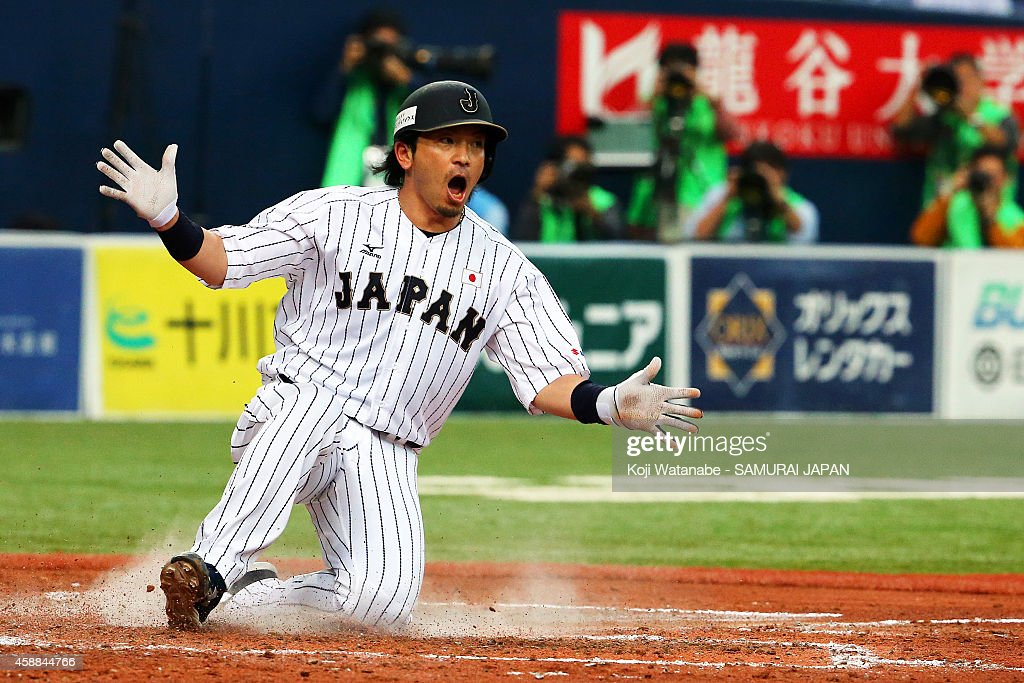 Infielder Nobuhiro Matsuda of Samurai Japan celerates after scoring in the bottom half of the fourth inning during the game one of Samurai Japan and...