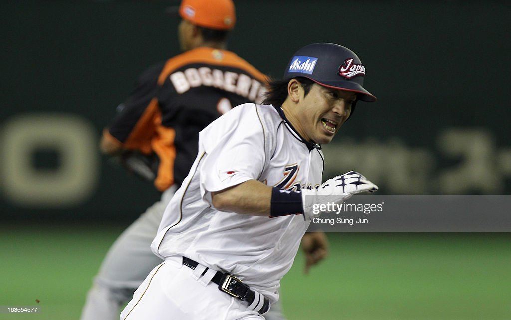Infielder <a gi-track='captionPersonalityLinkClicked' href=/galleries/search?phrase=Nobuhiro+Matsuda&family=editorial&specificpeople=8673842 ng-click='$event.stopPropagation()'>Nobuhiro Matsuda</a> #5 runs to home base in the eighth inning during the World Baseball Classic Second Round Pool 1 game between Japan and the Netherlands at Tokyo Dome on March 12, 2013 in Tokyo, Japan.