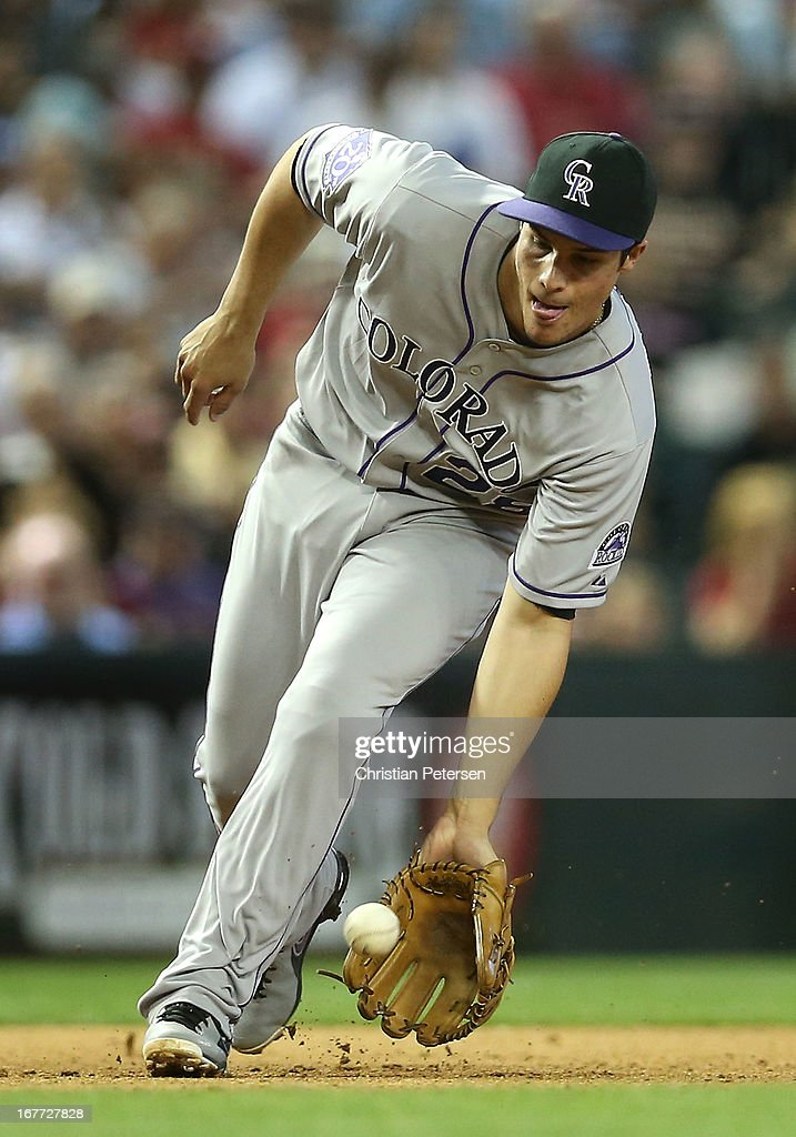 Infielder Nolan Arenado #28 of the Colorado Rockies fields a ground ball out against the Arizona Diamondbacks during the fifth inning of the MLB game at Chase Field on April 28, 2013 in Phoenix, Arizona.
