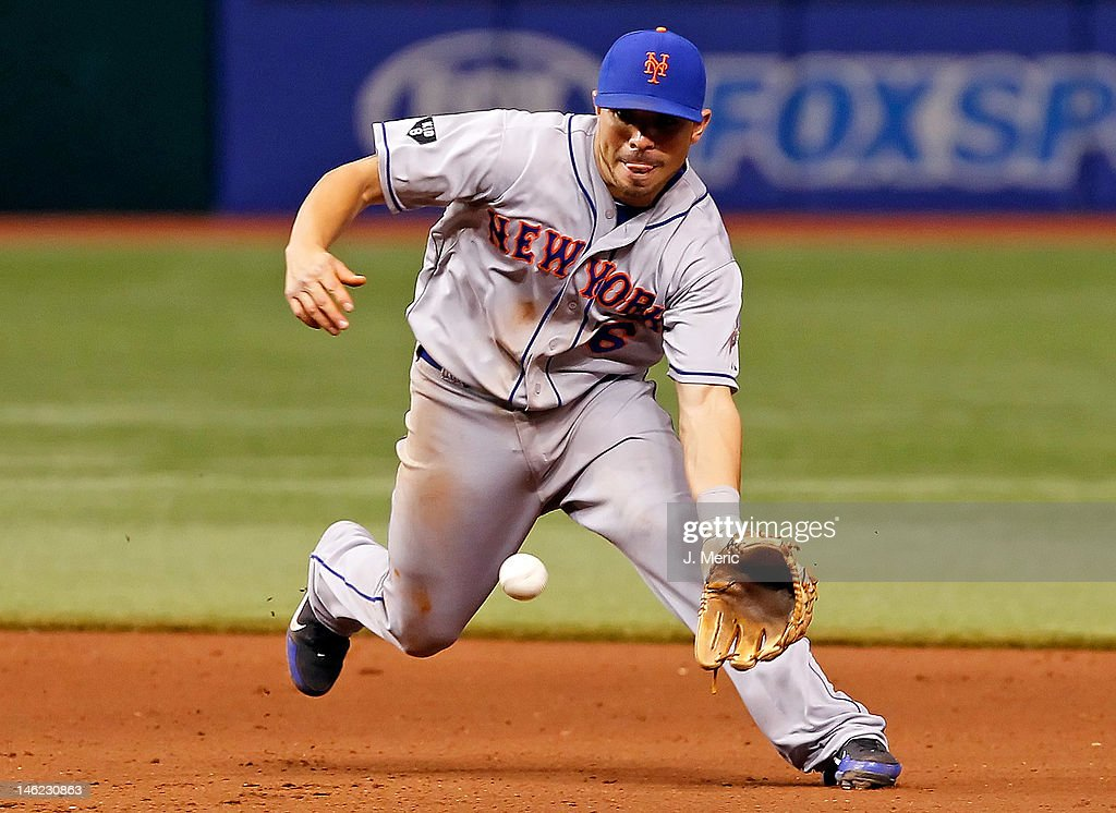 Infielder Omar Quintanilla #6 of the New York Mets fields a ground ball against the Tampa Bay Rays during the game at Tropicana Field on June 12, 2012 in St. Petersburg, Florida.