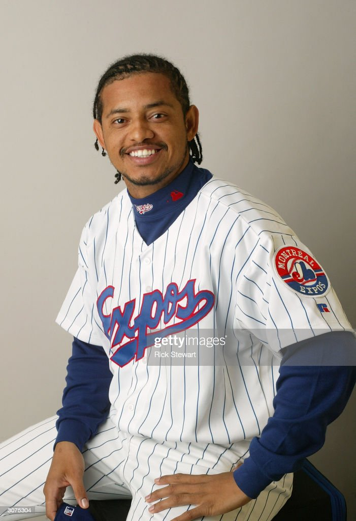 Infielder Orlando Cabrera #18 of the Montreal Expos poses for a photo during Media Day at Space Coast Stadium on February 28, 2004 in Viera, Florida.