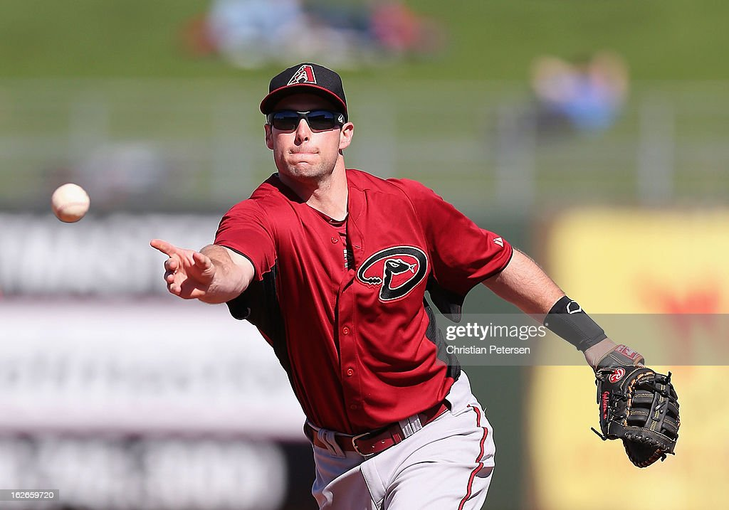 Infielder <a gi-track='captionPersonalityLinkClicked' href=/galleries/search?phrase=Paul+Goldschmidt&family=editorial&specificpeople=7511120 ng-click='$event.stopPropagation()'>Paul Goldschmidt</a> #44 of the Arizona Diamondbacks flips the ball to the pitcher for an out during the spring training game against the Kansas City Royals at Surprise Stadium on February 25, 2013 in Surprise, Arizona.