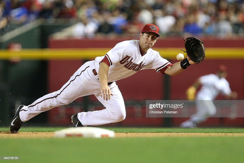 Infielder <a gi-track='captionPersonalityLinkClicked' href=/galleries/search?phrase=Paul+Goldschmidt&family=editorial&specificpeople=7511120 ng-click='$event.stopPropagation()'>Paul Goldschmidt</a> #44 of the Arizona Diamondbacks makes a diving catch during the sixth inning of the MLB game against the Los Angeles Dodgers at Chase Field on April 11, 2014 in Phoenix, Arizona.