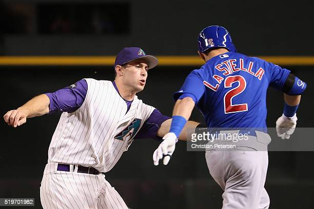 Infielder Paul Goldschmidt of the Arizona Diamondbacks tags out Tommy La Stella of the Chicago Cubs during the third inning of the MLB game at Chase...