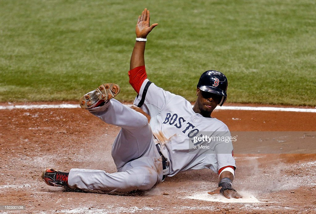 Infielder <a gi-track='captionPersonalityLinkClicked' href=/galleries/search?phrase=Pedro+Ciriaco&family=editorial&specificpeople=5718591 ng-click='$event.stopPropagation()'>Pedro Ciriaco</a> #77 of the Boston Red Sox scores a run against the Tampa Bay Rays during the game at Tropicana Field on September 18, 2012 in St. Petersburg, Florida.