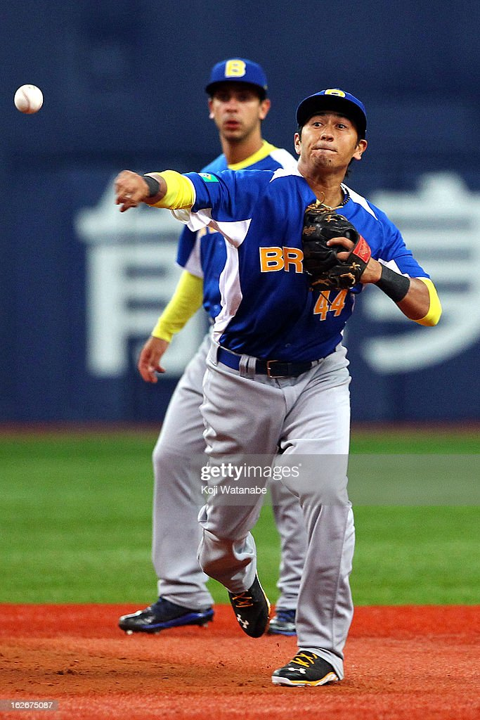 Infielder Pedro Okuda #44 of Brazil in action during in the bottom half of the second inning the friendly game between Orix Buffaloes and Brazil at Kyocera Dome Osaka on February 26, 2013 in Osaka, Japan.