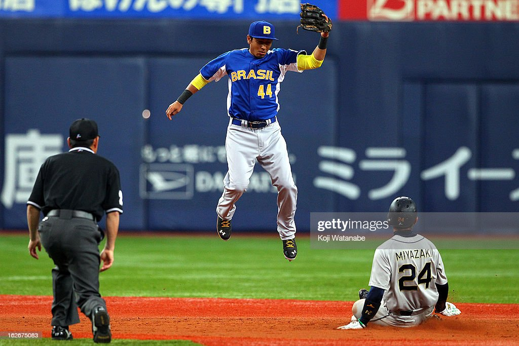 Infielder Pedro Okuda #44 of Brazil in action with Yuki Miyazaki of Orix Buffaloes in the bottom half of the third inning during the friendly game between Orix Buffaloes and Brazil at Kyocera Dome Osaka on February 26, 2013 in Osaka, Japan.