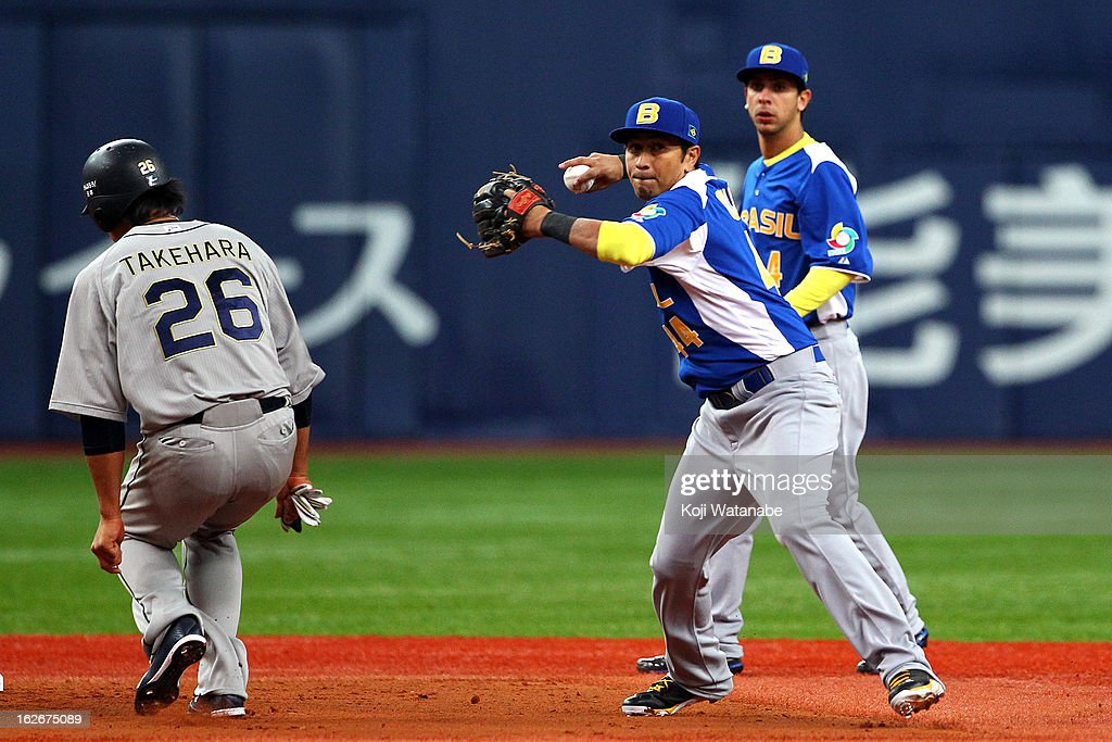 Infielder Pedro Okuda #44 of Brazil in the bottom half of the second inning during the friendly game between Orix Buffaloes and Brazil at Kyocera Dome Osaka on February 26, 2013 in Osaka, Japan.