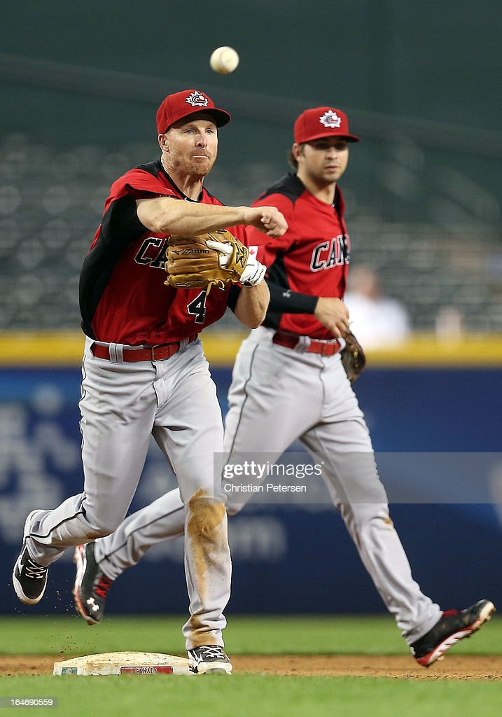 Infielder Pete Orr of Canada fields a ground ball out against Italy during the World Baseball Classic First Round Group D game at Chase Field on...