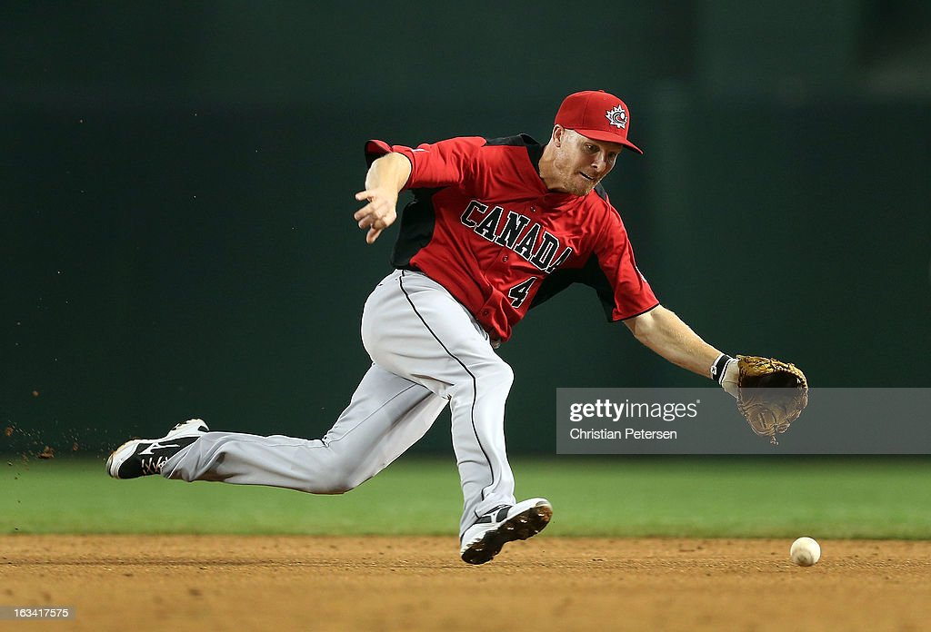 Infielder <a gi-track='captionPersonalityLinkClicked' href=/galleries/search?phrase=Pete+Orr&family=editorial&specificpeople=643375 ng-click='$event.stopPropagation()'>Pete Orr</a> #4 of Canada fields a ground ball out against Mexico during the World Baseball Classic First Round Group D game at Chase Field on March 9, 2013 in Phoenix, Arizona.