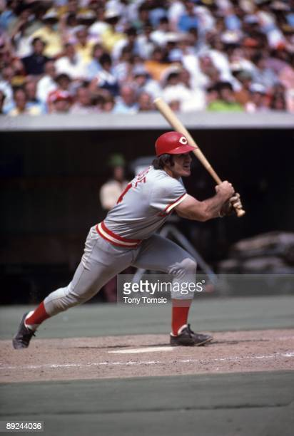 Infielder Pete Rose of the Cincinnati Reds watches a ball he's just hit during a game in August 1975 against the Pittsburgh Pirates at Three Rivers...