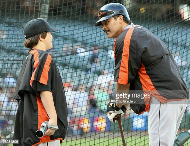 Infielder Rafael Palmeiro of the Baltimore Orioles talks to his son Preston during practice for the game against the Seattle Mariners on July 14 2005...