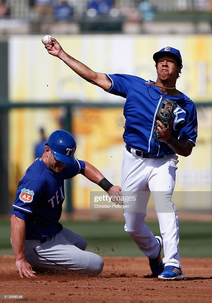 Infielder Raul Mondesi of the Kansas City Royals throws over the sliding Justin Ruggiano of the Texas Rangers to complete a double play during the...