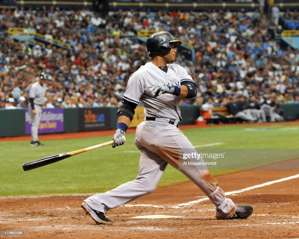 Infielder Robinson Cano #24 of the New York Yankees bats against the Tampa Bay Rays August 25, 2013 at Tropicana Field in St. Petersburg, Florida. Cano homered in the 4th inning. The Yankees won 3 - 2.