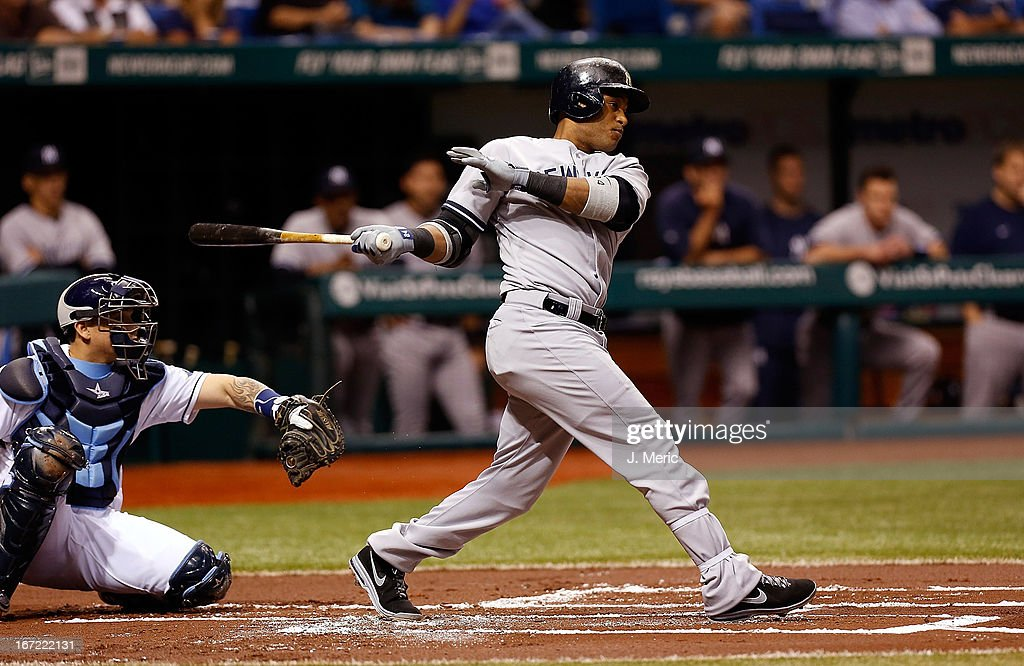 Infielder <a gi-track='captionPersonalityLinkClicked' href=/galleries/search?phrase=Robinson+Cano&family=editorial&specificpeople=538362 ng-click='$event.stopPropagation()'>Robinson Cano</a> #24 of the New York Yankees fouls off a pitch against the Tampa Bay Rays during the game at Tropicana Field on April 22, 2013 in St. Petersburg, Florida.