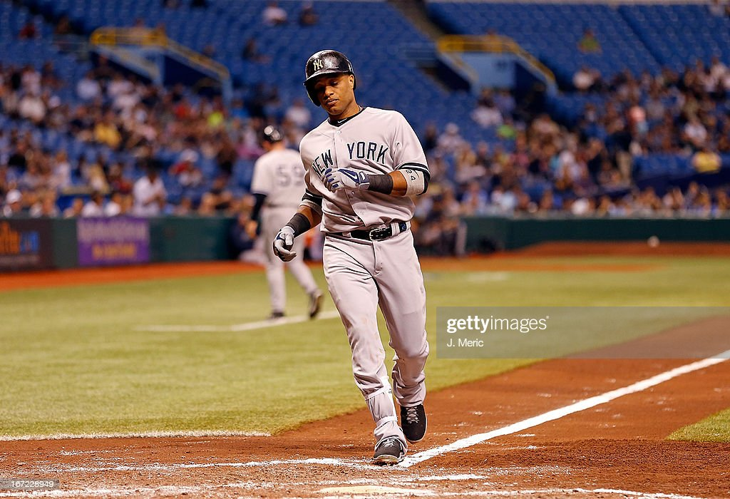 Infielder <a gi-track='captionPersonalityLinkClicked' href=/galleries/search?phrase=Robinson+Cano&family=editorial&specificpeople=538362 ng-click='$event.stopPropagation()'>Robinson Cano</a> #24 of the New York Yankees rounds the bases after his fourth inning home run against the Tampa Bay Rays during the game at Tropicana Field on April 22, 2013 in St. Petersburg, Florida.