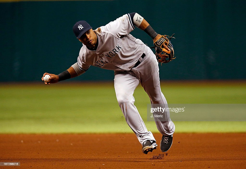 Infielder <a gi-track='captionPersonalityLinkClicked' href=/galleries/search?phrase=Robinson+Cano&family=editorial&specificpeople=538362 ng-click='$event.stopPropagation()'>Robinson Cano</a> #24 of the New York Yankees throws over to first for an out in the fifth inning against the Tampa Bay Rays during the game at Tropicana Field on April 23, 2013 in St. Petersburg, Florida.