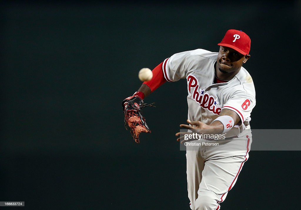 Infielder <a gi-track='captionPersonalityLinkClicked' href=/galleries/search?phrase=Ryan+Howard&family=editorial&specificpeople=551402 ng-click='$event.stopPropagation()'>Ryan Howard</a> #6 of the Philadelphia Phillies fields a ground ball out against the Arizona Diamondbacks during the MLB game at Chase Field on May 10, 2013 in Phoenix, Arizona. The Diamondbacks defeated the Phillies 3-2.