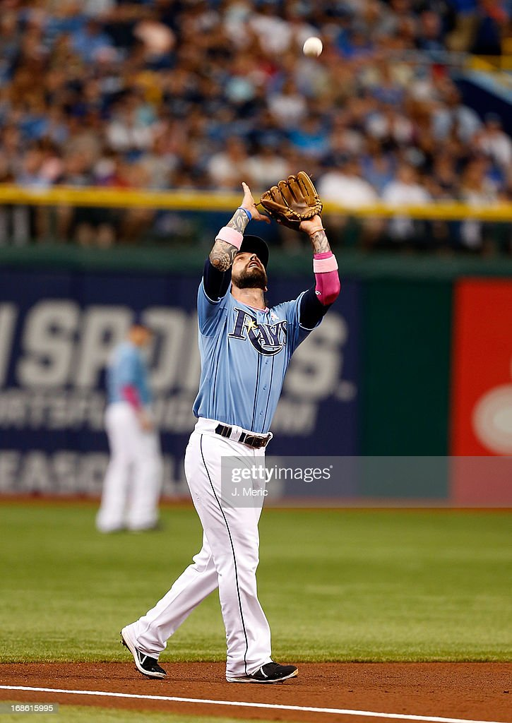 Infielder Ryan Roberts #19 of the Tampa Bay Rays catches a fly ball against the San Diego Padres during the game at Tropicana Field on May 12, 2013 in St. Petersburg, Florida.