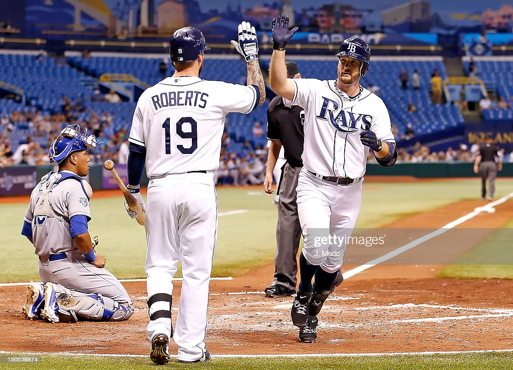 Infielder Ryan Roberts #19 of the Tampa Bay Rays congratulates <a gi-track='captionPersonalityLinkClicked' href=/galleries/search?phrase=Jeff+Keppinger&family=editorial&specificpeople=835796 ng-click='$event.stopPropagation()'>Jeff Keppinger</a> #7 after his home run against the Kansas City Royals during the game at Tropicana Field on August 20, 2012 in St. Petersburg, Florida.