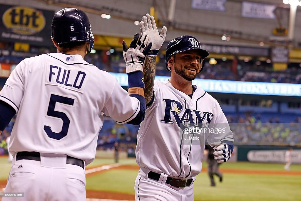 Infielder Ryan Roberts #19 of the Tampa Bay Rays is congratulated after his home run against the Baltimore Orioles during the game at Tropicana Field on October 3, 2012 in St. Petersburg, Florida.