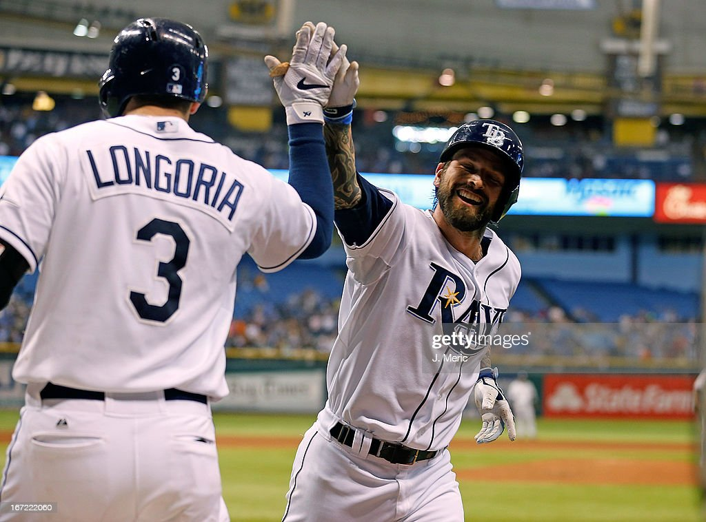 Infielder Ryan Roberts #19 of the Tampa Bay Rays is congratulated by <a gi-track='captionPersonalityLinkClicked' href=/galleries/search?phrase=Evan+Longoria&family=editorial&specificpeople=2349329 ng-click='$event.stopPropagation()'>Evan Longoria</a> #3 after his second home run of the game against the New York Yankees at Tropicana Field on April 22, 2013 in St. Petersburg, Florida.