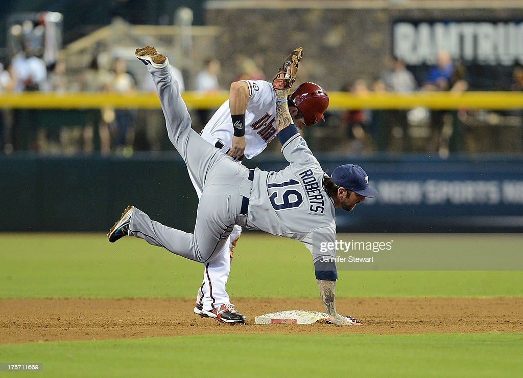 Infielder Ryan Roberts #19 of the Tampa Bay Rays turns the double play while attempting to avoid <a gi-track='captionPersonalityLinkClicked' href=/galleries/search?phrase=Adam+Eaton&family=editorial&specificpeople=210898 ng-click='$event.stopPropagation()'>Adam Eaton</a> #6 of the Arizona Diamondbacks in the third inning at Chase Field on August 6, 2013 in Phoenix, Arizona.