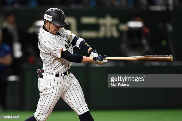Infielder Ryosuke Kikuchi of Japan hits a RBI single to make it 40 in the bottom of the sixth inning during the World Baseball Classic Pool E Game...