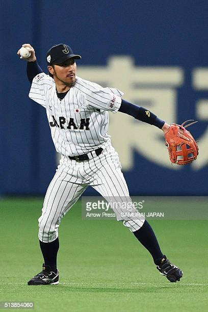 Infielder Ryosuke Kikuchi of Japan throws in the top of sixth inning during the international friendly match between Japan and Chinese Taipei at the...