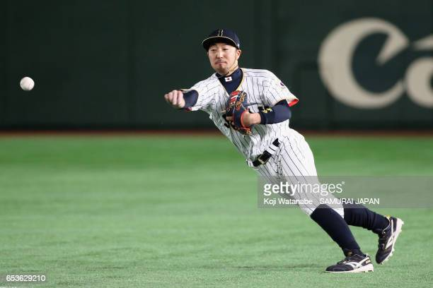 Infielder Ryosuke Kikuchi of Japan throws to the first base after fielding a grounder by Sam Fuld of Israel in the top of the sixth inning during the...