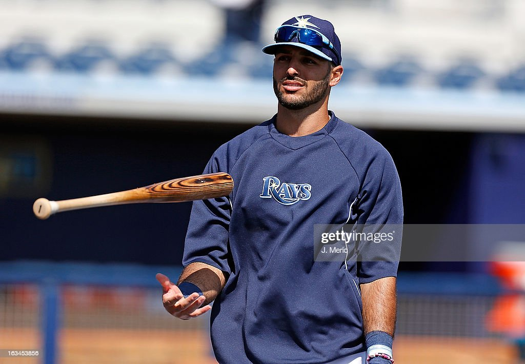 Infielder Sean Rodriguez #1 of the Tampa Bay Rays flips his bat during batting practice just before the Grapefruit League Spring Training Game against the Boston Red Sox at the Charlotte Sports Complex on March 10, 2013 in Port Charlotte, Florida.