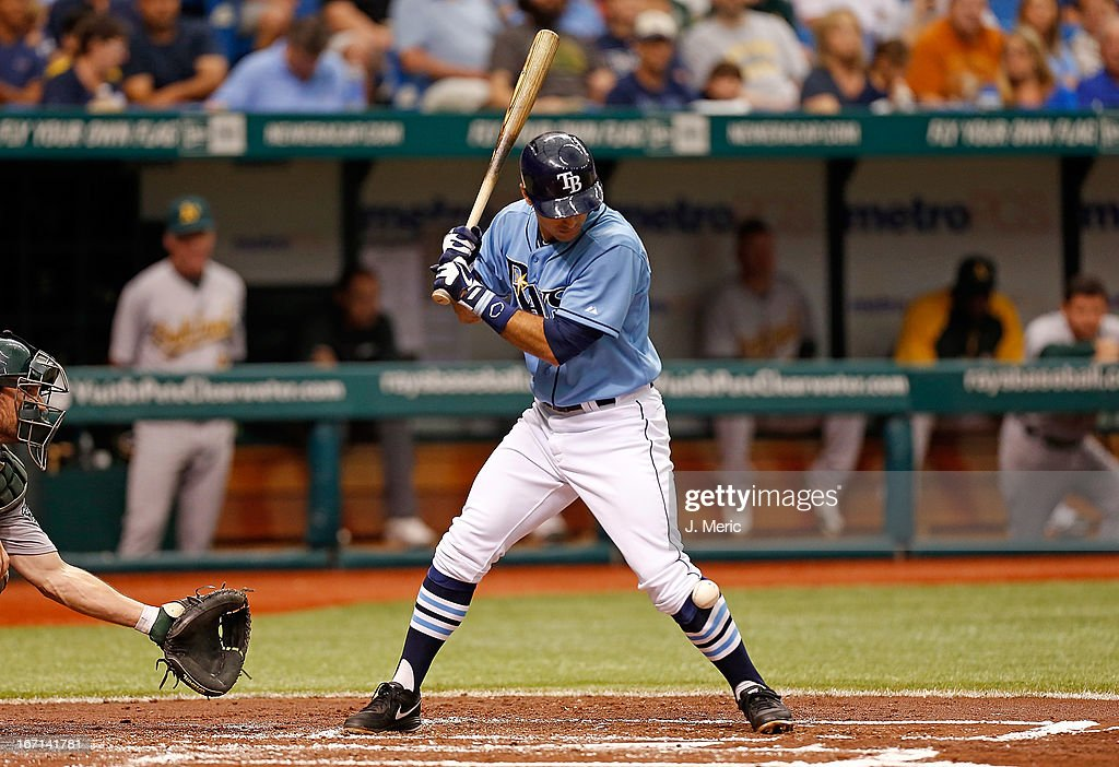Infielder <a gi-track='captionPersonalityLinkClicked' href=/galleries/search?phrase=Sean+Rodriguez&family=editorial&specificpeople=4171805 ng-click='$event.stopPropagation()'>Sean Rodriguez</a> #1 of the Tampa Bay Rays is hit by a pitch against the Oakland Athletics during the game at Tropicana Field on April 21, 2013 in St. Petersburg, Florida.
