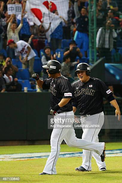 Infielder Sho Nakata of Japan celebrates a threerun homerun with his team mateTakeya Nakamura in the top of sixth inning during the WBSC Premier 12...
