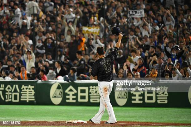 Infielder Sho Nakata of Japan applauds fans at the beginning of the bottom of the third inning during the World Baseball Classic Pool E Game Two...