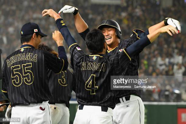 Infielder Sho Nakata of Japan celebrates with his team mate infielder Ryosuke Kikuchi and Shogo Akiyama after hitting a solo homer in the top of the...
