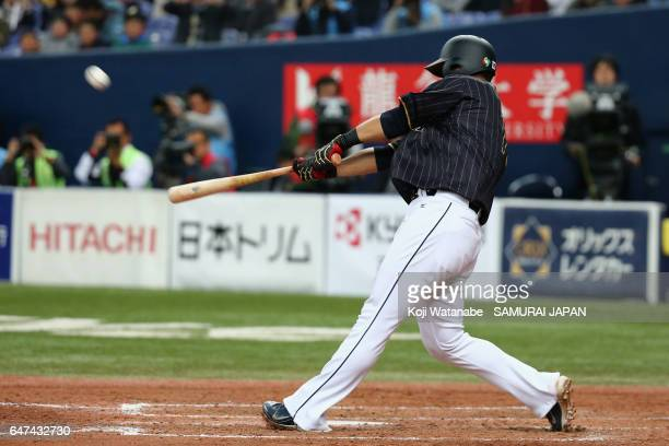 Infielder Sho Nakata of Japan hits a solo homer in the top of the seventh inning during the World Baseball Classic WarmUp Game between Japan and...