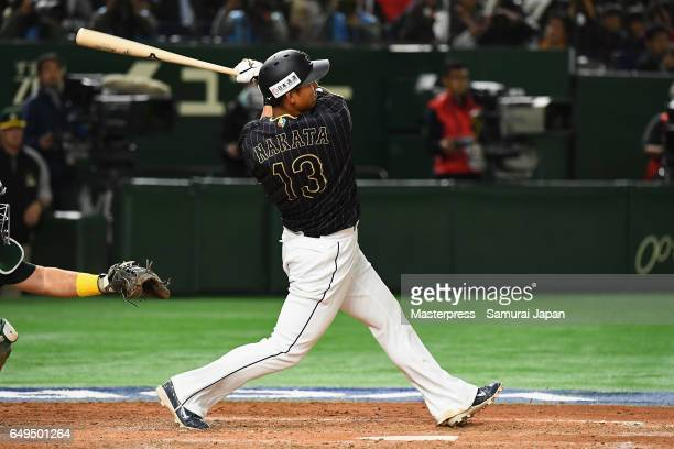Infielder Sho Nakata of Japan hits a solo homer in the top of the seventh inning during the World Baseball Classic Pool B Game Three between Japan...