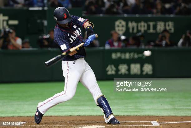 Infielder Shuta Tonosaki of Japan hits a solo homer in the top of second inning during the Eneos Asia Professional Baseball Championship 2017 game...