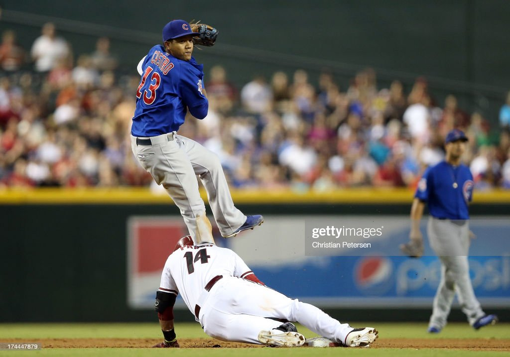 Infielder <a gi-track='captionPersonalityLinkClicked' href=/galleries/search?phrase=Starlin+Castro&family=editorial&specificpeople=5970945 ng-click='$event.stopPropagation()'>Starlin Castro</a> #13 of the Chicago Cubs collides with <a gi-track='captionPersonalityLinkClicked' href=/galleries/search?phrase=Martin+Prado&family=editorial&specificpeople=620159 ng-click='$event.stopPropagation()'>Martin Prado</a> #14 of the Arizona Diamondbacks as he slides into second base during the fifth inning of the MLB game at Chase Field on July 25, 2013 in Phoenix, Arizona. The Diamondbacks defeated the Cubs 3-1.