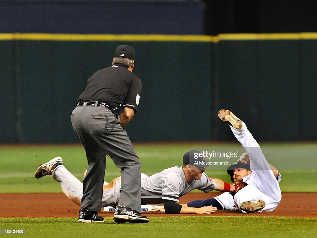 Infielder Stephen Drew #7 of the Boston Red Sox tags out sliding designated hitter Matt Joyce of the Tampa Bay Rays in a fourth-inning attempted steal September 12, 2013 at Tropicana Field in St. Petersburg, Florida.