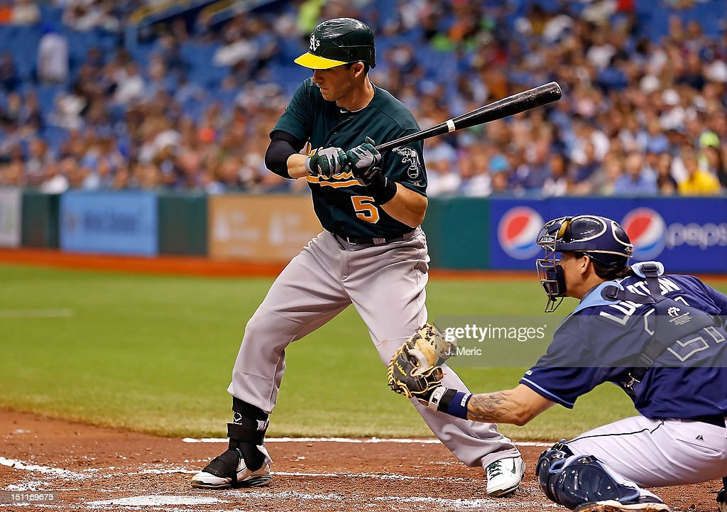 Infielder <a gi-track='captionPersonalityLinkClicked' href=/galleries/search?phrase=Stephen+Drew&family=editorial&specificpeople=757520 ng-click='$event.stopPropagation()'>Stephen Drew</a> #5 of the Oakland Athletics bats against the Tampa Bay Rays during the game at Tropicana Field on August 25, 2012 in St. Petersburg, Florida.