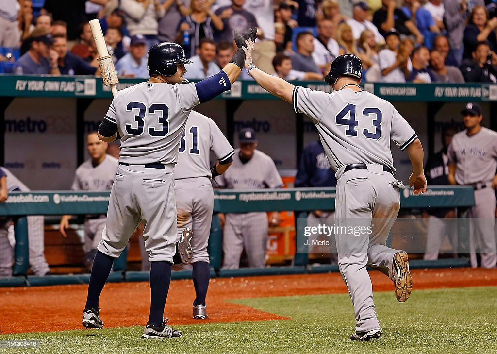 Infielder Steve Pearce #43 of the New York Yankees is congratulated by <a gi-track='captionPersonalityLinkClicked' href=/galleries/search?phrase=Nick+Swisher&family=editorial&specificpeople=206417 ng-click='$event.stopPropagation()'>Nick Swisher</a> #33 after scoring against the Tampa Bay Rays during the game at Tropicana Field on September 5, 2012 in St. Petersburg, Florida.