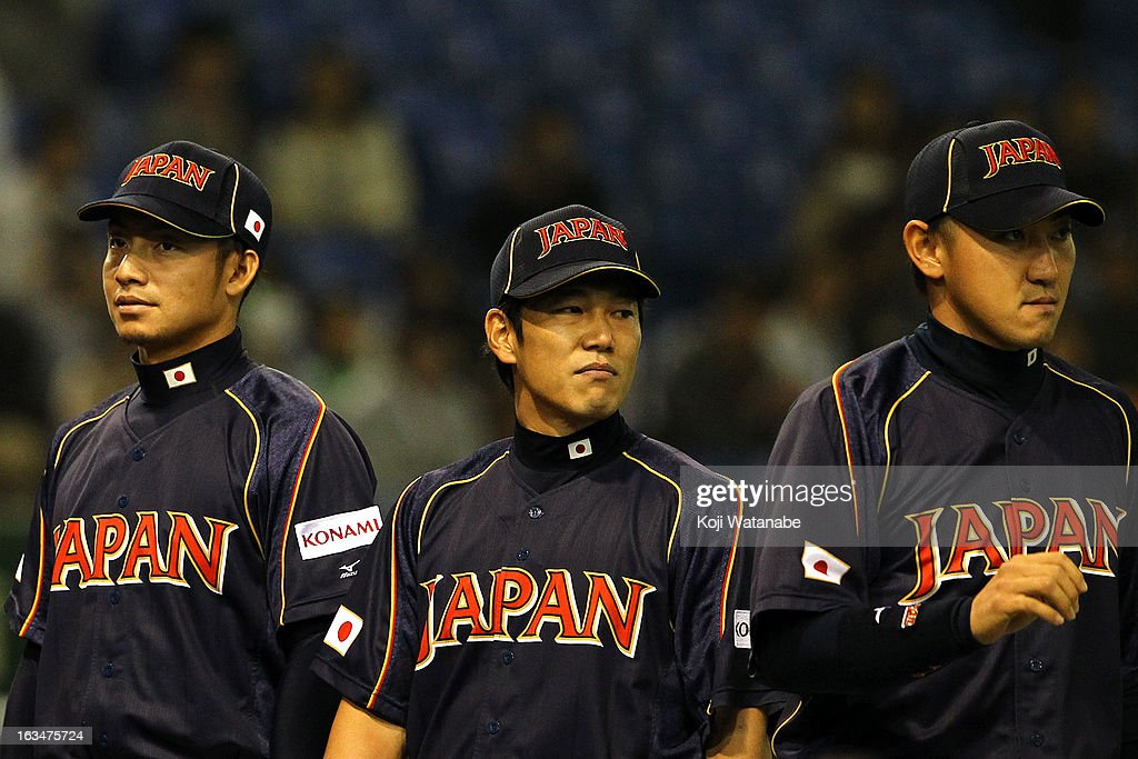 Infielder Takashi Toritani #1 and Infielder Hirokazu Ibata #3 and Outfielder Seiichi Uchikawa #24 of Japan look on during the World Baseball Classic Second Round Pool 1 game between Japan and the Netherlands at Tokyo Dome on March 10, 2013 in Tokyo, Japan.