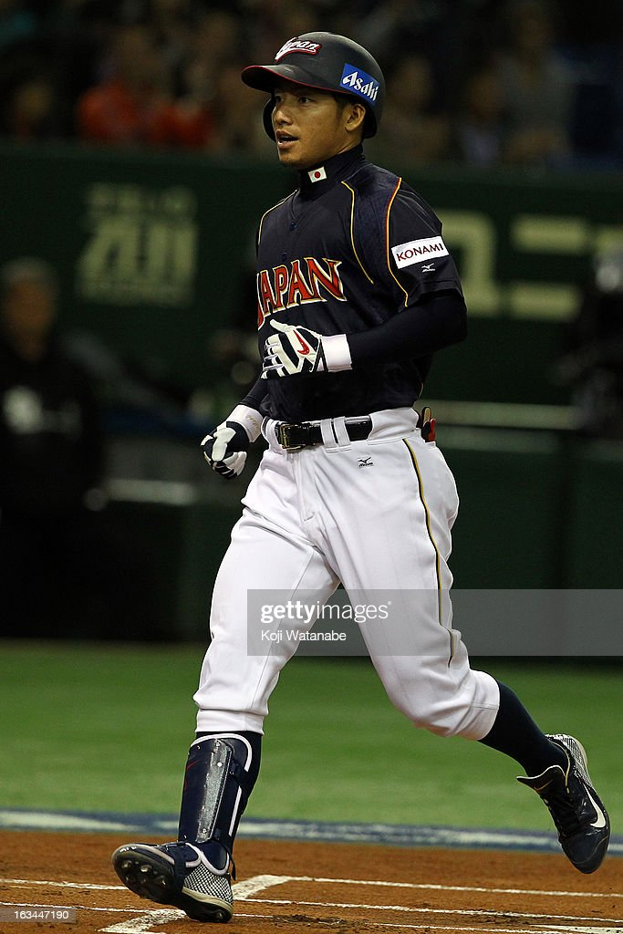 Infielder Takashi Toritani #1 of Japan celebrates after scoring hits a homer in the top half of the first inning during the World Baseball Classic Second Round Pool 1 game between Japan and the Netherlands at Tokyo Dome on March 10, 2013 in Tokyo, Japan.