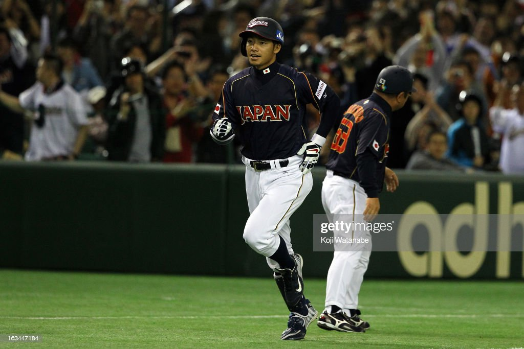 Infielder Takashi Toritani #1 of Japan celerates after scoring hits a homer in the top half of the first inning during the World Baseball Classic Second Round Pool 1 game between Japan and the Netherlands at Tokyo Dome on March 10, 2013 in Tokyo, Japan.